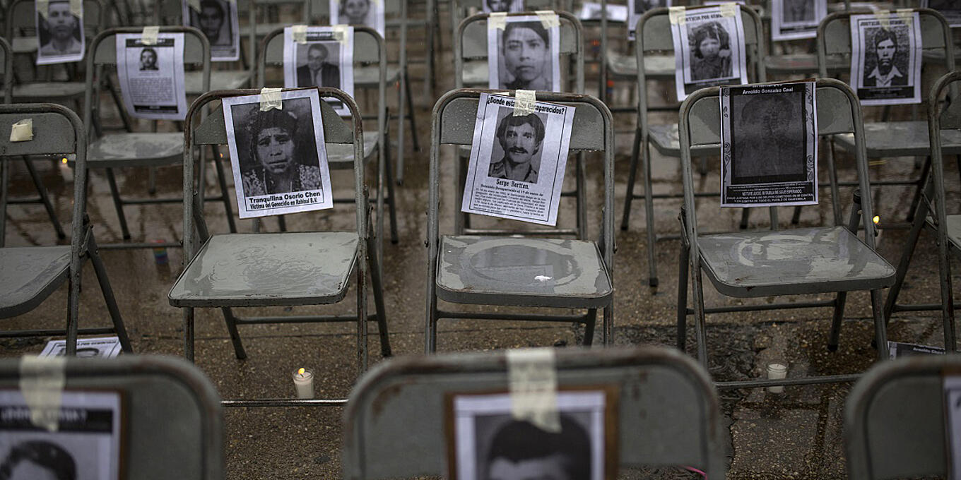 Reflecting on the importance of psychosocial support for families missing loved ones - image: chairs bearing portraits of people who were dissapeared in Guatemala, Credit: Castillo,M/Keystone